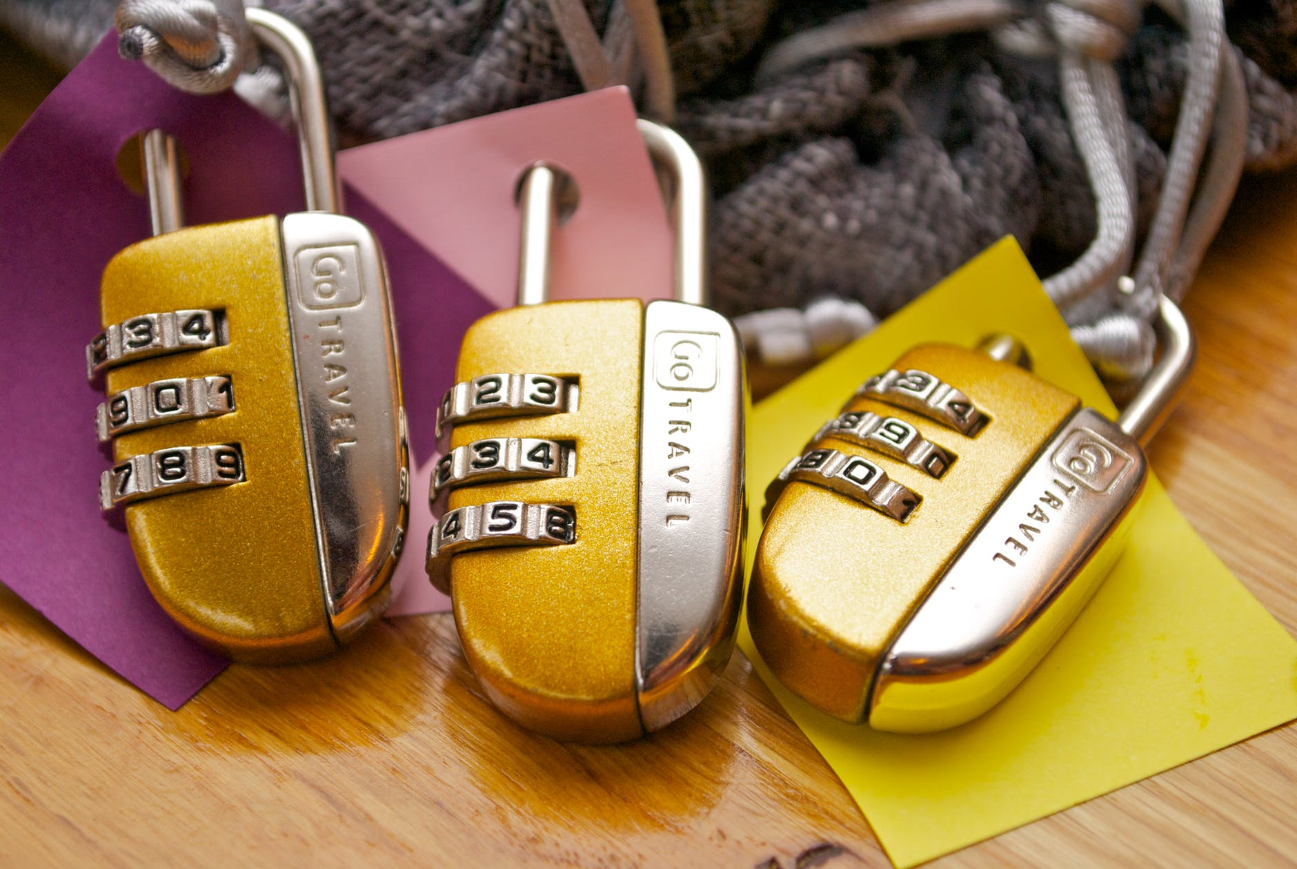 three gold and silver combination padlocks
