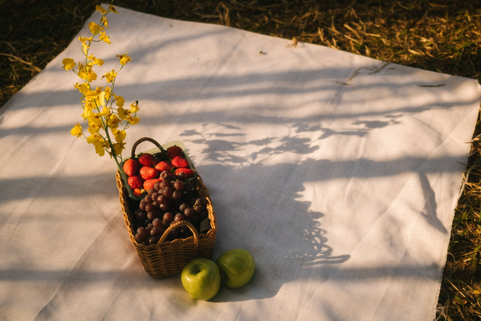 basket of fruit on white cloth